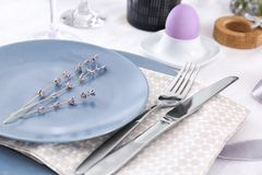 Beautiful festive Easter table setting with lavender Royalty Free Stock Images