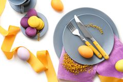 Beautiful festive Easter table setting with mimosa Stock Photography
