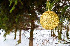 Beautiful festive elegant yellow, golden round balls, Christmas decorations for the new year, Christmas hanging on fir branches royalty free stock photography