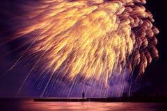 Beautiful, festive, fireworks like a golden rain over the sea wi Stock Image