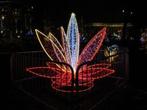 Beautiful festive magic sculpture in the form of a red lily flower at the Festival of Illuminations NeoYear 2018 on Sofia in Kiev royalty free stock images