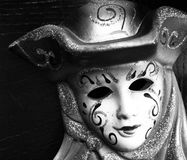 Beautiful festive mask. At the carnival, art, face, sad, festivity, disguise, black and white, wallpaper, background stock photo