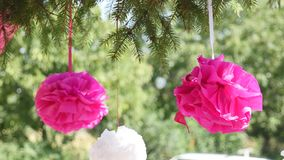 Beautiful festive paper flowers hanging on ropes.  stock video