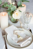 Beautiful festive table setting. With flowers, candles, white table cloth and napkins, close-up Stock Photography