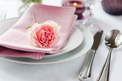 Beautiful festive table setting with roses Stock Photo