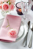 Beautiful festive table setting with roses Royalty Free Stock Image