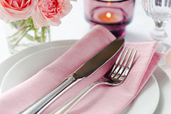 Beautiful festive table setting with roses Royalty Free Stock Photo