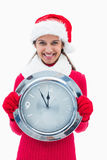 Beautiful festive woman holding clock Royalty Free Stock Images
