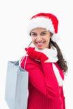 Beautiful festive woman holding shopping bag Stock Photography