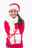 Beautiful festive woman offering gift Royalty Free Stock Images