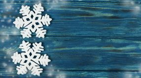 Beautiful festive wooden background  texture of blue color. With decoration on the Christmas tree with toys snowflakes white and snow Stock Photography
