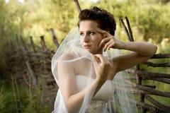 Beautiful fiancee. Horizontal wedding portrait beautiful  fiancee in white dress with wedding veil, on nature Stock Photography