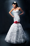 Beautiful fiancee in nuptial dress with red bow Stock Photos