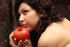 Beautiful fiancee with a pomegranate Stock Images