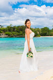 Beautiful fiancee in white wedding dress with big long white tra Royalty Free Stock Photography