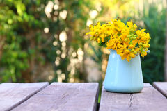 Beautiful field flowers on wooden table outdoors afternoon Royalty Free Stock Photography