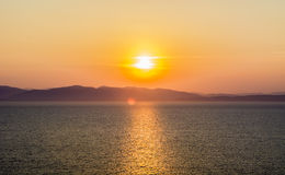 Beautiful fiery sunset over the sea. A beautiful sunset over the sea of fire, fire the Sun sit over the sea, and other islands Royalty Free Stock Photography