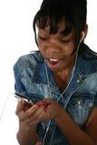 Beautiful Fifteen Year Old Tee. Beautiful African Amercian 15 year old Teen Girl with digital music player Stock Photos