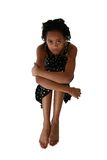 Beautiful Fifteen Year Old Tee. Beautiful African Amercian 15 year old Teen Girl sitting barefoot in dress over white Royalty Free Stock Photo