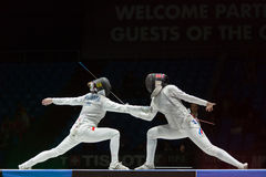 Beautiful fight on championship of world in fencing Stock Photo