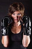 Beautiful fighter woman in boxing gloves Royalty Free Stock Photos