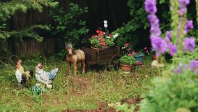 Beautiful figures of animals in a private garden. Beautiful decor. The care of the garden stock footage