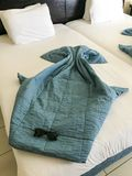 Beautiful figures of sea rays made from blankets, duvet covers on the bed with sunglasses stock photography
