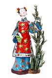A beautiful figurine of a chinese lady. A beautiful figurine of a chinese lady isolated over white background Royalty Free Stock Images