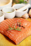Beautiful filet of salmon on the wooden background Royalty Free Stock Photography