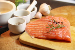 Beautiful filet of salmon on the wooden background Royalty Free Stock Photos