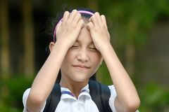 Beautiful Filipina School Girl Under Stress. A young pretty asian girl child royalty free stock photography