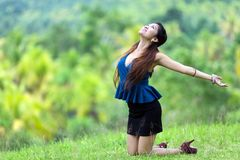 Beautiful Filipina woman rejoicing Stock Photography