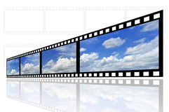 Beautiful film strip. Cloud and sky background on film strip Stock Images