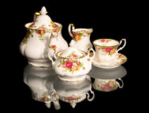 Beautiful fine-China Tea Set. Consists of a tea pot, a sugar bowl set, a creamer set Royalty Free Stock Image