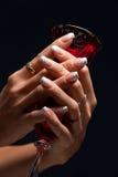 Beautiful fingernails plus glass Royalty Free Stock Images