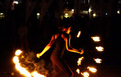 Beautiful fire dancing girl Stock Image