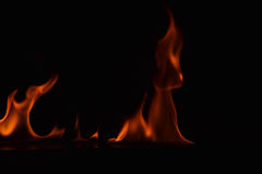 Beautiful fire flames on black background Stock Photo