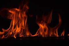 Beautiful fire flames on black background Royalty Free Stock Photo
