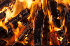 Beautiful fire with flames charred wood Royalty Free Stock Photo