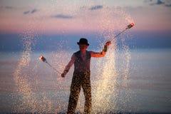 Beautiful fire poi spinning stock photo