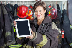 Beautiful Firewoman Showing Digital Tablet At Fire Stock Photos