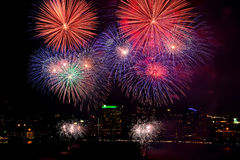 Beautiful firework on city background. Beautiful firework and dark sky on city background Royalty Free Stock Photo