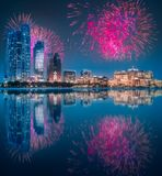 Beautiful fireworks above Abu Dhabi Skyline at night, UAE. Beautiful fireworks above Abu Dhabi Skyline at night with reflection on water, United Arab Emirates royalty free stock image