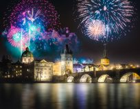 Beautiful fireworks above Charles bridgeat at night, Prague, Czech Republic stock photography