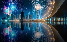 Beautiful fireworks above Dubai Business bay, UAE. Beautiful fireworks above Dubai Business bay at evening light, UAE royalty free stock photos