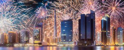 Beautiful fireworks above Dubai Business bay, UAE royalty free stock photos