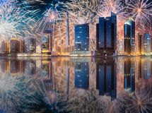 Beautiful fireworks above Dubai Business bay, UAE. Beautiful fireworks above Dubai Business bay at evening light, UAE stock photos