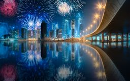 Beautiful fireworks above Dubai Business bay, UAE. Beautiful fireworks above Dubai Business bay at evening light, UAE stock images