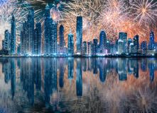 Beautiful fireworks above Dubai Marina bay, UAE. Beautiful fireworks above Dubai Marina bay at night with fireworks, UAE stock photo