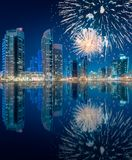 Beautiful fireworks above Dubai Marina bay, UAE. Beautiful fireworks above Dubai Marina bay at night with fireworks, UAE royalty free stock photography